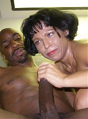 Mature woman Bambi meets up with her black stud and got her pussy stretched after sucking his big dick