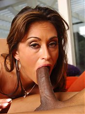 Hot MILF with big boobs Claudia Valentine lures a black dude into plugging inside her box