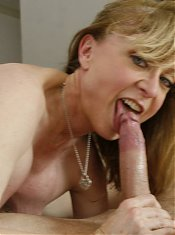 Beautiful mature pornstar Nina Hartley exposes her sexy ass while fucking a younger guy live